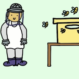 A man in protective clothing stands next to a beehive
