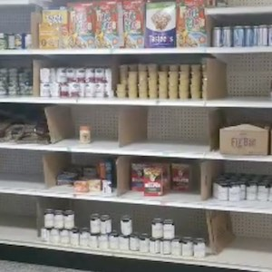 Shelves are lined with donated canned food