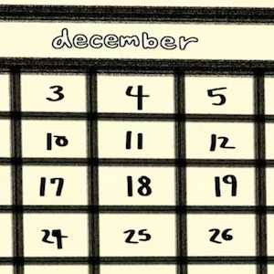 A closeup of a page from a calendar shows the month of December