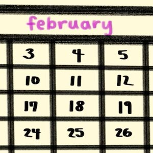 A closeup of a page from a calendar shows the month of February