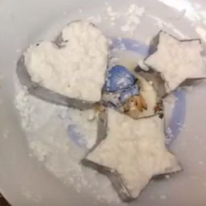 Marshmallows in heart and star shapes on a plate