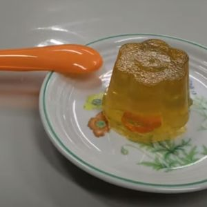 Finished orange jelly sits on a plate