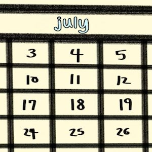 A closeup of a page from a calendar shows the month of July