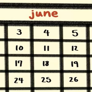 A closeup of a page from a calendar shows the month of June