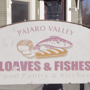 A close-up shot of the Loaves and Fishes business sign