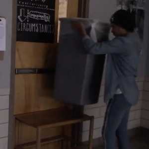A student builds a barricade to prevent someone from entering a classroom