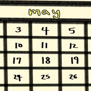 A closeup of a page from a calendar shows the month of May