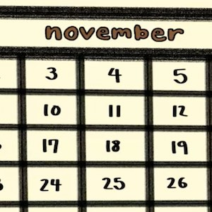 A closeup of a page from a calendar shows the month of November