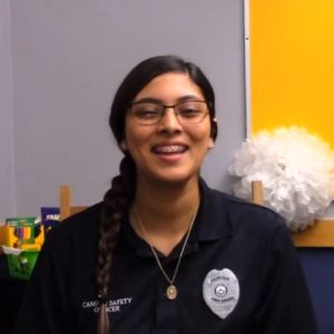 A proud campus safety officer smiles as she talks about her job