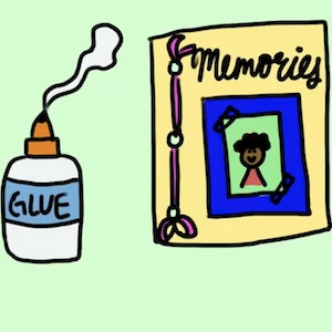 A bottle of glue spills out on the table next to a book of memories