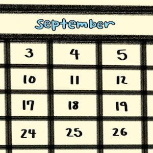 A closeup of a page from a calendar shows the month of September