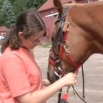 Learn how this young woman takes care of animals and helps children at the same time